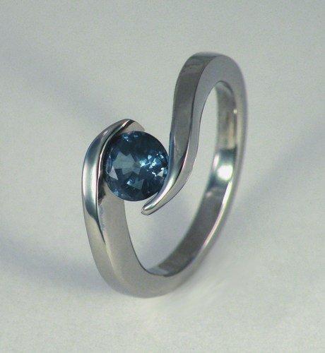 wave_titanium_1_carat_genuine_blue_sapphire_tension_set_ring_28b77048