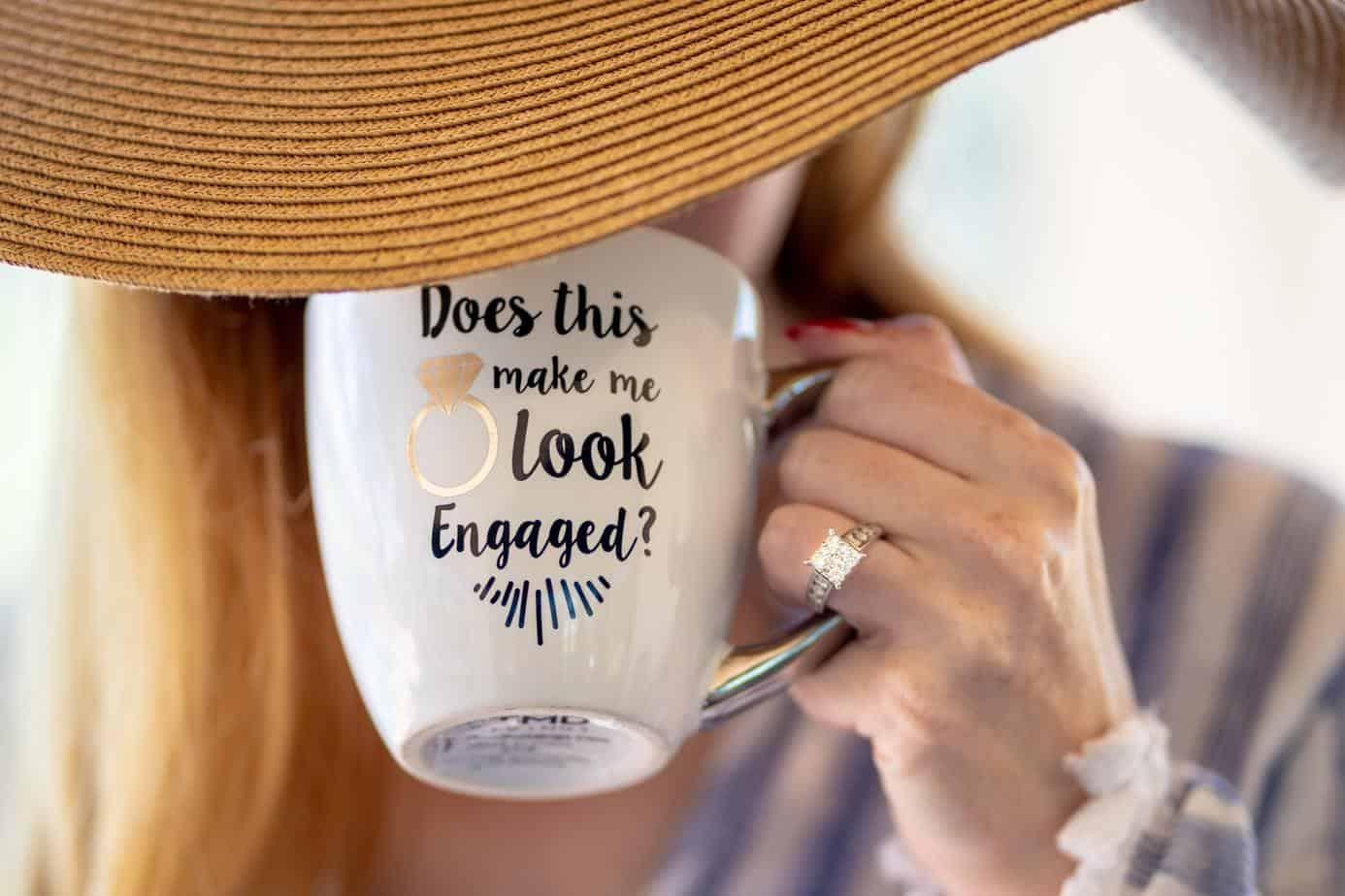 person holding white ceramic mug
